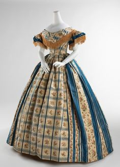 If Scarlett O'Hara wore her curtains, why wouldn't other 1860s girl sport her table-cloth? It looks fabulous!  Evening dress, 1857-1860