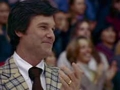 Kurt Russel as the ice hockey coach Herb Brooks in the sports drama Miracle based on the real Miracle on Ice where US beat Soviet Union in Ice Hockey.