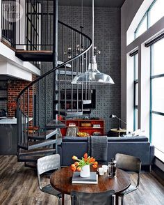 That winding staircase, the charcoal colour scheme, the industrial vibe…simply obsessed! #Scoutlofts #loftliving #interiordesign #decor