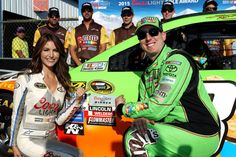 Kyle Busch, #18 M&M's Crispy Toyota, and Miss Coors Light Amanda Mertz pose with the Coors Light Pole Award after Busch qualifyied on the pole for the NASCAR Sprint Cup Series Windows 10 400 at Pocono Raceway on July 31, 2015 in Long Pond, Pennsylvania.
