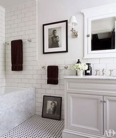 Black and White: basket weave tile on the floor, subway tile with gray grout, marble tub panel