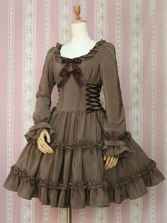 This elegant long-sleeved dress has a classic style. The solid color of the dress is set off by a diamond-shaped neckline trimmed in frills, with removable bow pins decorating the bodice and laces up Victorian Fashion, Vintage Fashion, Diesel Punk, Frock Design, Cosplay Dress, Mori Girl, Mode Vintage, Retro Vintage, Steampunk Clothing