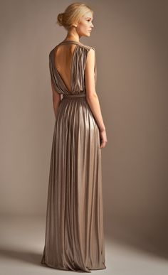 Unleash your inner Greek Goddess in the Temperley London Long Athena Dress. Made of foil printed jersey, it has a heavily draped shape that perfectly complements the metallic fabric as well as elongating and flattering the body The cross over v bust and low v back complete the look of this glorious gown. Fabric Composition: 90% polyamide 10% elastane, lining; 100% polyester True to size Model is 5ft 10 and is wearing a size 8