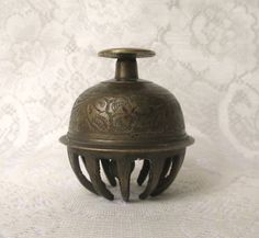 Elephant Bell or Claw Bell Cage. These were worn by elephants to alert people of its path