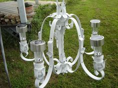 Out door chandelier made with solar lights. Interesting idea, but I'd want to find some prettier solar lights. Solar Light Chandelier, Outdoor Chandelier, Chandeliers, Solar Lights, Chandelier Tree, Chandelier Ideas, White Chandelier, Vintage Chandelier, Shabby Chic Dining