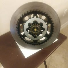 Wall clock made from used Harley Davidson brake rotor, motorcycle rear chain sprocket, automatic transmission internal part, and automotive engine crankshaft timing gear. SOLD