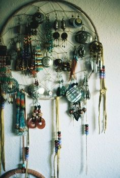 hey want dome super cool way to hang your earings? try a dream catcher on the wall