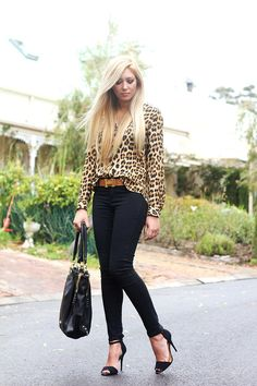leopard print blouse, dark wash denim skinnies, hermes belt, and black heeled sandals...