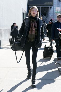 Incredible Model Street Style Outfits From New York Fashion Week - chic fur coat and jewel  toned printed scarf + black skinny jeans and lace-up boots