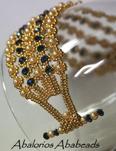 such a beautiful bracelet made with gold seeds, pearls and crystals.  M...m