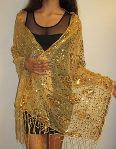 Gold evening shawls wraps many designer evening wear so you can choose the best one for you on sale. http://www.yourselegantly.com/advanced_search_result.php?keywords=gold+evening+wrap&x=0&y=0