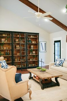Love the industrial-style bookshelves for an office, with stained top, shiplap in back, and metal accents.