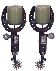 Set of two spur candle wall sconces. Real cast iron construction that has a great weathered and rusted finish. Hand-painted poly resin conchos and embellishments added for an authentic western look. T