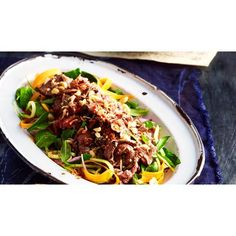 Tangy beef salad recipe - By Australian Women's Weekly, With the classic sweet, salty, sour Thai flavours, crunchy nuts and moist, tender lamb, we've got flavour and texture well and truly covered with this tangy beef salad.