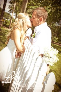 Country Bride And Groom Kiss In Garden