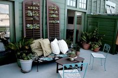 As beautiful as it is useful, herbs,flowers, or vines planted in shutters is a sure way to spruce a patio or deck