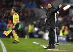 Barcelona's coach Luis Enrique gestures from the sideline during the UEFA Champions League Round of 16 second leg football match FC Barcelona vs Arsenal FC at the Camp Nou stadium in Barcelona on March 16, 2016.
