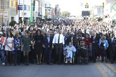 The first family and John Lewis leads the crowd in Selma's Alabama
