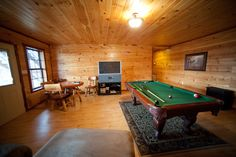 Game room with pool table at the Lake House at Beavers Bend State Park.