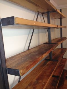 Forever Interiors custom shelving made from reclaimed BC fir. Steel supports make it sleek and modern.