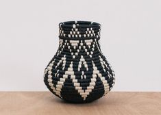 HANDWOVEN IN RWANDAIntricately crafted with timeless tradition, this carefully dyed sisal fiber and sweet grass vase makes a stunning statement piece. One or more of these vases, will make a globally conscious and stylistic addition to your home. Black And White Vase, Agave Plant, Apt Ideas, Eco Friendly House, Rustic Chic, Sisal, African Art, Hand Weaving, Artisan