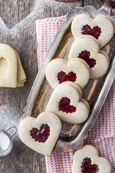 These Raspberry Linzer Heart cookies make a perfect Valentine's Day gift. With a buttery, tender shortbread base and a sweet raspberry jam filling, they're sure to delight. Valentine Desserts, Valentines Food, Christmas Desserts, Christmas Treats, Christmas Baking, Jelly Cookies, Linzer Cookies, Heart Cookies, Baking Recipes