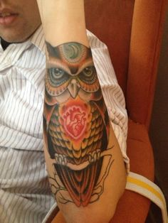 Owl tattoo with red heart
