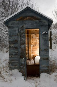 Outhouse that is covered in a wintertime snow. We still used one out back our church when I was a little gal. And our family cottage at bible camp had them just up until several years ago when they finally updated & got them out of there...whewie~~