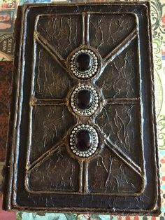 Altered book cover, made by @almafication at Instagram. Click the book to enter the Flickr album containing more photos.