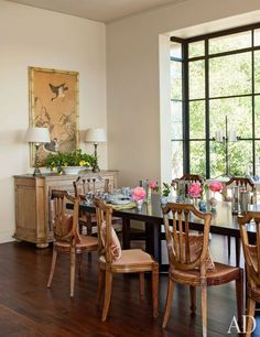 Montecito Dining Room  18th-century Japanese watercolor from Tom Stansbury Antiques is set against a wall painted in a Benjamin Moore beige; 19th-century Italian walnut chairs from Circa Antiques ring a table from Therien & Co.