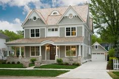 I like the siding color (gray) with the white trim around the windows. I also like the dark wood front door. I would want a storm door as well.