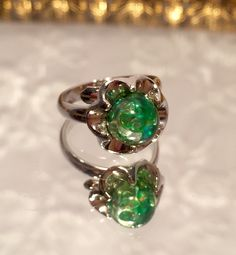 Vintage Judy Lee Mystic Green Glitter Ring Size 6 Adjustable Ring by LovingCupVintageKM on Etsy https://www.etsy.com/listing/226304186/vintage-judy-lee-mystic-green-glitter