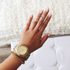 Expensive gold watch and bracelet rings nails acrylic neutral pink perfect fashionable style