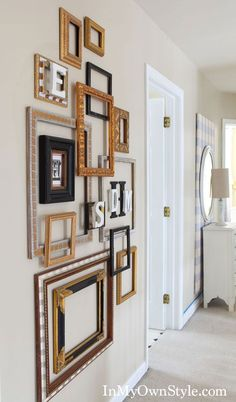 We all know custom frames are true works of art in and of themselves. Here's an instillation of empty frames all artfully layered to create fantastic wall decor!