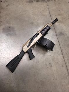 SBR saiga 12 gauge shot gun, based on a AK platform. Fun as hell to shoot