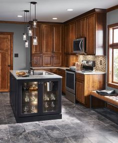 Gray neutrals and stainless steel appliances create a stunning