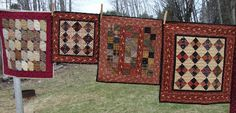 HomeSpunPrims: LITTLE QUILTS ALL IN A ROW - Love the color choices, red always a favorite.