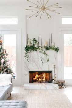 These holiday fireplace decor ideas are modern but so festive. Since the mantel is a eye catching part of most homes, so this will help Christmas-ify it! decor Modern Holiday Fireplace Decor Ideas and Inspiration - An Unblurred Lady Decor, Fireplace Mantels, Diy Holiday Decor, Marble Fireplaces, Fireplace Design, Christmas Fireplace, Fireplace Surrounds, Fireplace, Holiday Fireplace