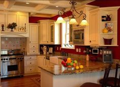 red kitchen walls cream cabinets black countertops - Google Search