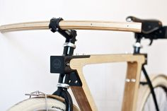 wood.b  wooden bicycle  designboom.com.  Overcomplicates a simple proven design just for the desire to add wood...pointless..