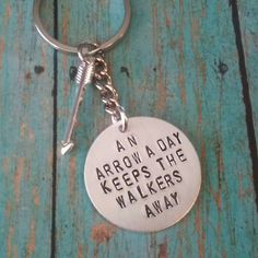 Check out this item in my Etsy shop https://www.etsy.com/listing/214699140/the-walking-dead-arrow-keychain
