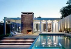 clean and modern. with a pool and lots of window. great fireplace too.