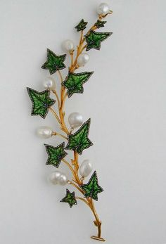 An Art Nouveau Enamel, Diamond and Pearl Ivy Leaf Tiara/Corsage Brooch by ART NOUVEAU : The British Antique Dealers' Association. I like this brooch because it reminds me of a tree branch, which relates to my forest theme. Enamel Jewelry, Pearl Jewelry, Jewelry Art, Antique Jewelry, Vintage Jewelry, Fine Jewelry, Jewelry Design, Jewellery, Pearl Earrings