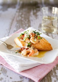 Shrimp Boats.  Shrimp sauteed with garlic, shallots, sun-dried tomatoes, butter and wine then poured into a hollowed out baguette. Oh yeah, then it's topped with parmesan cheese.