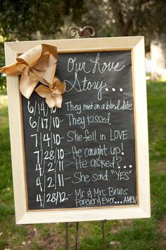 Use a chalkboard sign to share your love story at wedding reception