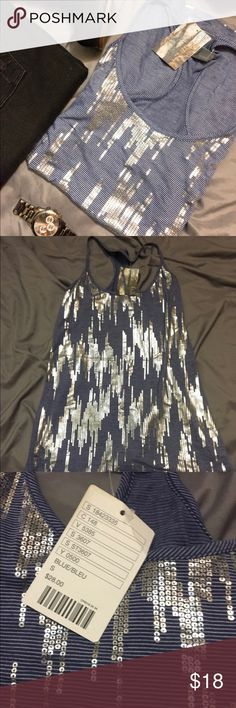 NWT Sparkle and Fade Tank Sparkle and fade stripped racer back tank from urban outfitters. Silver screen printing on front. 🚫No trades, selling only. 🙂Please make offers with the make offer button 🙂PayPal through Depop. Thanks for checking out my closet! Urban Outfitters Tops Tank Tops