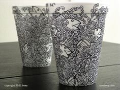 The U.S artist / illustrator Cheeming Boey decided to use his art on polystyrene disposable cups, just with a marker.