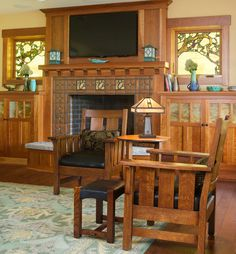 A Cottage Makeover on Lake Charlevoix - Arts & Crafts style - Motawi tiles were added to the fireplace surround; vintage Lifetime chairs flank a Gustav Stickley - Craftsman Living Rooms, Craftsman Decor, Craftsman Furniture, Craftsman Interior, Craftsman Style Homes, Craftsman Bungalows, Craftsman Houses, Craftsman Style Interiors, Cottage Dining Rooms