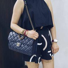 instagram: @quennandher // chanel perfect edge navy blue flap bag // cmeo collective shorts // hermes kelly double tour bracelet // hermes rivale double tour bracelet