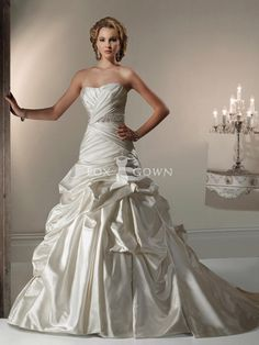 maybe a little too full, but I like the concept.     satin wedding dress with caught-up gown asymmetrically pleated bodice